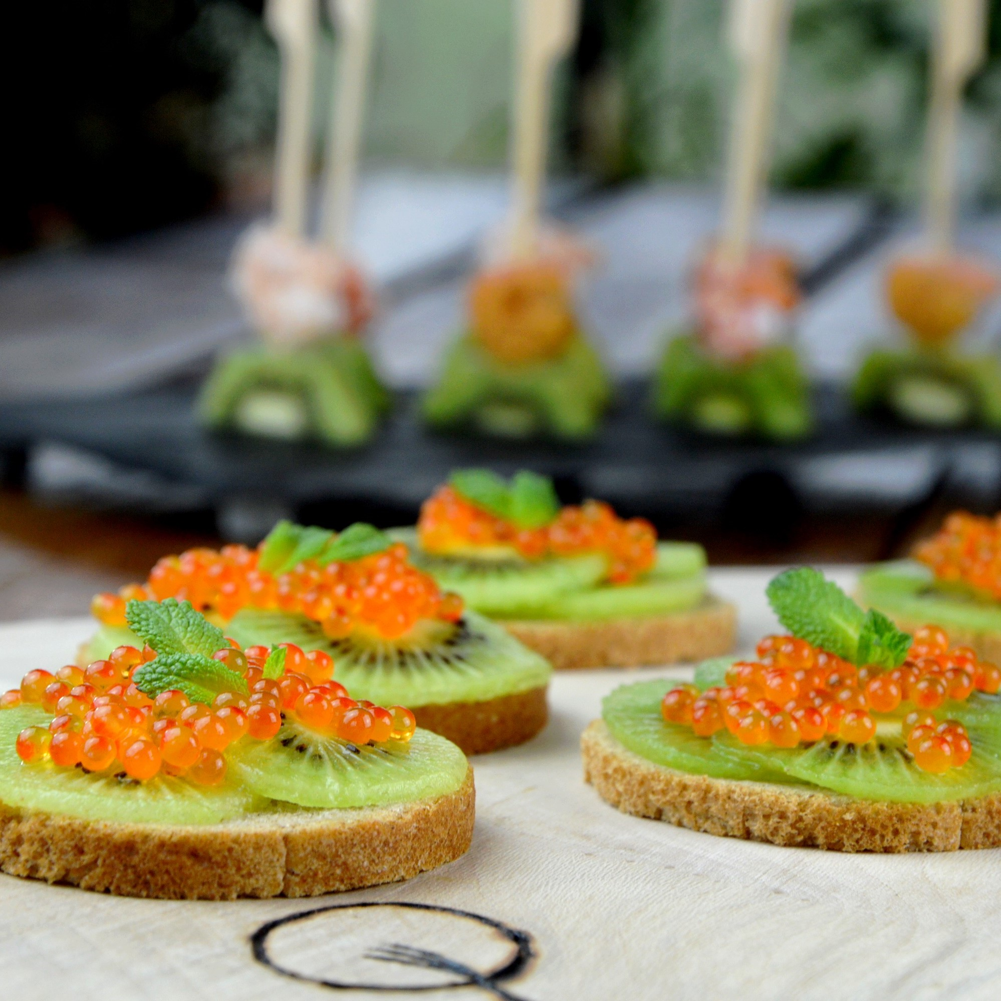 Kiwi fruits toast and trout eggs
